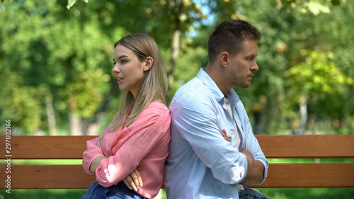 Pinturas sobre lienzo  Upset couple sitting back on bench at park, communication crisis, conflict