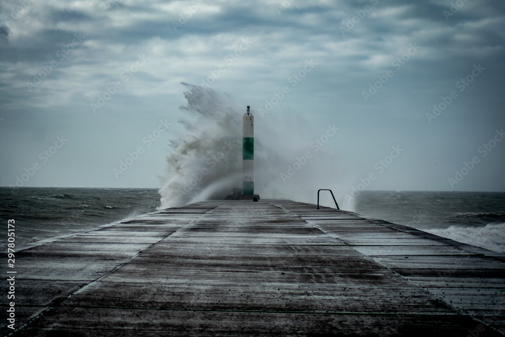 Fototapety, obrazy: Strong winds create big waves that batter into Aberystwyth, Mid Wales sea front during the Storm season.