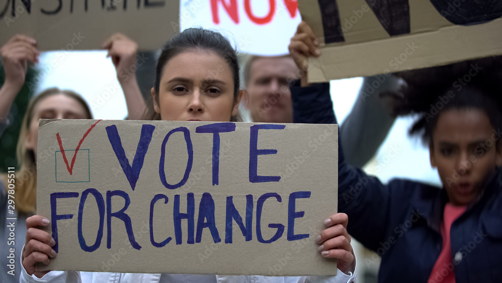 Fototapety, obrazy: Sad girl showing slogan Vote for change, presidential campaign rally, democracy