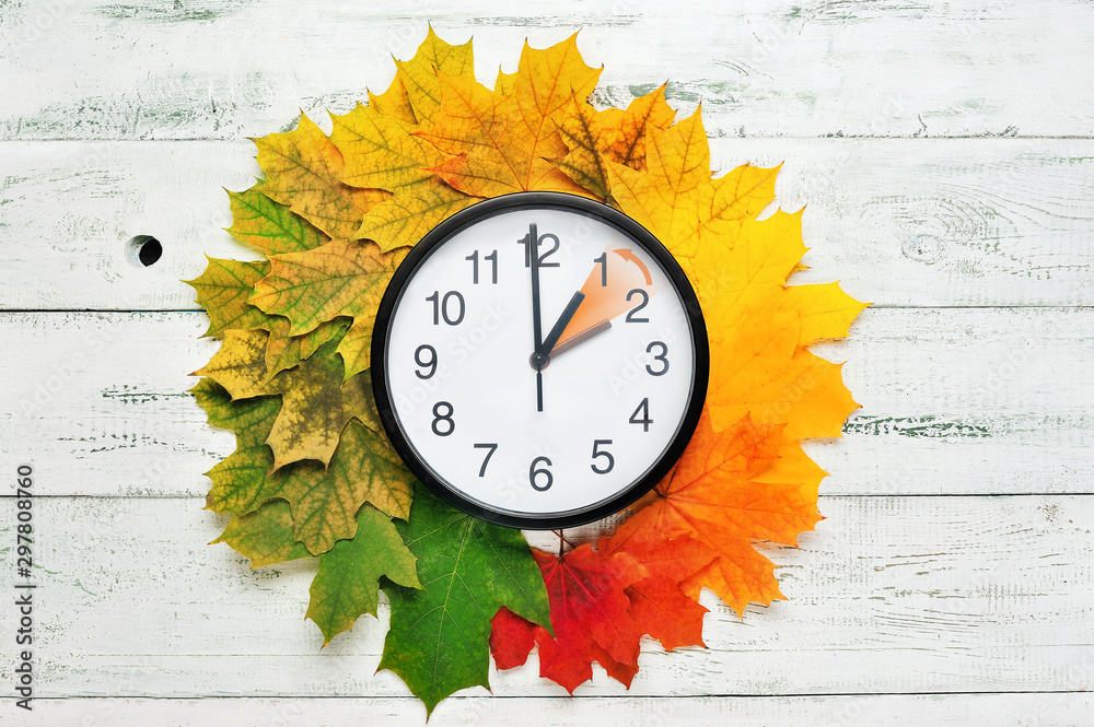 Fototapety, obrazy: Fall time change still life with maple tree foliage and wall clock