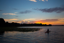 Daybreak At A Central Florida Lake With A Kayaker Rowing.