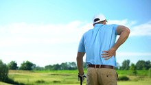 Male Golf Player Feeling Stron...