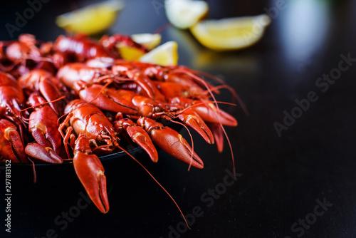 red crawfish with lemon on dark wood table Fototapet