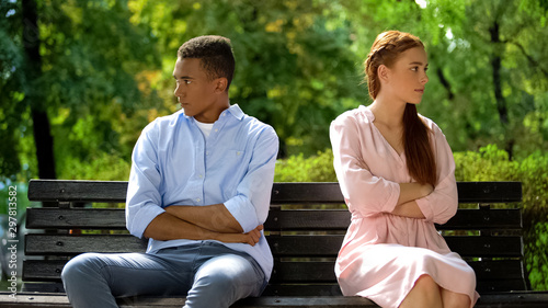 Two offended teenagers sitting on bench separately, quarrel, risk of break-up Canvas Print