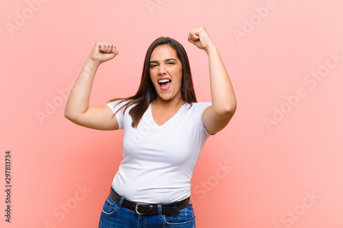 young pretty hispanic woman shouting triumphantly, looking like excited, happy a Billede på lærred