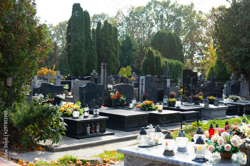 Graves at a Christian cemetery in autumn Wallpaper Mural