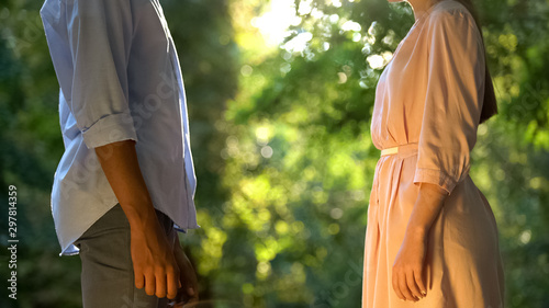 Fotografia  Young mixed-raced couple tenderly looking at each other, first date in park