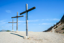 Three Wooden Cross In The Highlands Against The Blue Sky