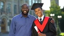 Proud Glad Father Hugging Grad...