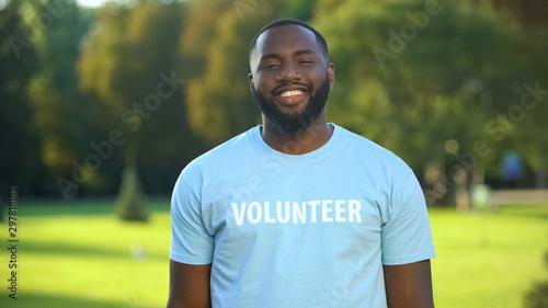 Carta da parati  Cheerful black male eco-volunteer smiling to camera, nature preservation project