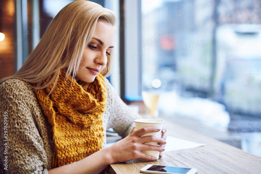 Fototapety, obrazy: Beautiful young woman warming up in cafe during cold winter day.