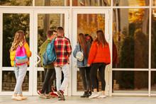 Group Of Teenage Students Near University