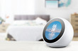 canvas print picture - Personal assistant alarmclock and loudspeaker on a white wooden shelf of a smart home bedroom. Empty copy space for Editor's text.