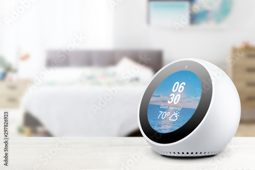 Personal assistant alarmclock and loudspeaker on a white wooden shelf of a smart home bedroom Wallpaper Mural