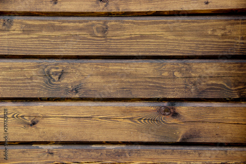 Fototapeta Texture of an edge siding made of old varnished panels