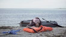 Unconscious Girl Lying On Boat Near Beach, Drowned Swimmer, Shipwreck Victim