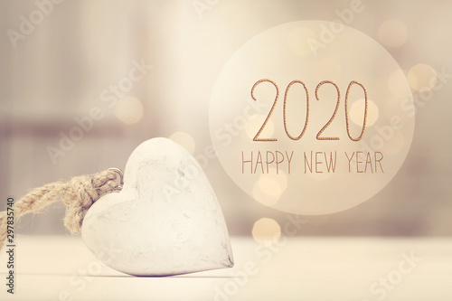 Fotografie, Obraz New Year 2020 message with a white heart in a room