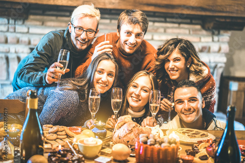 Fotobehang Kruidenierswinkel Happy friends on group photo selfie celebrating Christmas time with champagne and sweets food at dinner reunion party - Winter holiday concept with people having fun eating together - Warm filter