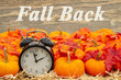 canvas print picture - Fall Back time change message with a retro alarm clock with pumpkins and fall leaves