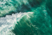 Aerial Wave Background. Drone Shot Directly From Above, Green Turquoise Color, Huge Waves. Empty Space