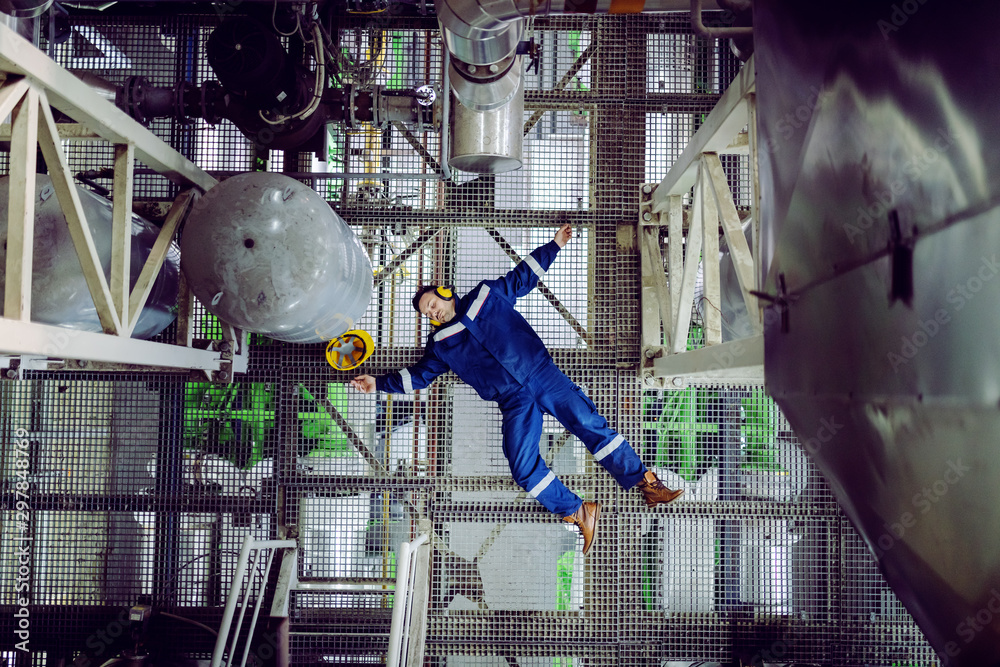 Fototapety, obrazy: Top view of unconscious plant worker. Injury at work concept.