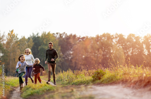 Fototapeta Young family having fun outdoors obraz