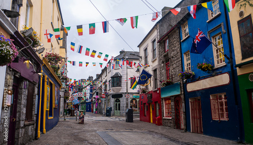 View of the main high street in Galway City with the brightly painted buildings Fotobehang