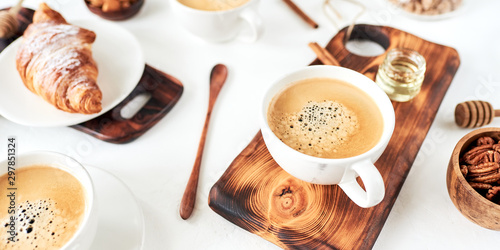 Breakfast with coffee and croissants on wooden table, top view - 297851324