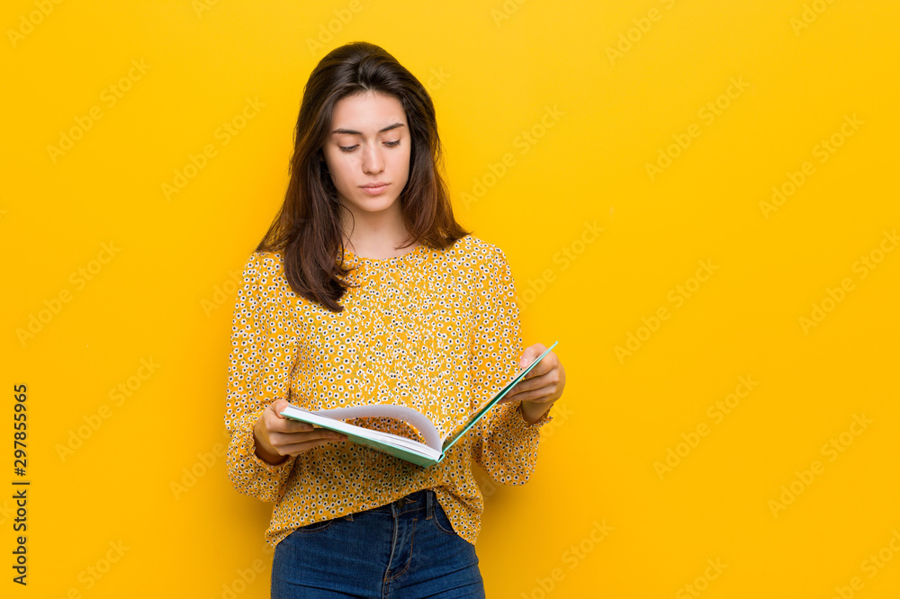 Fototapety, obrazy: Young caucasian woman holding some notebooks