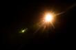 Leinwandbild Motiv abstract lens flare red light over black background