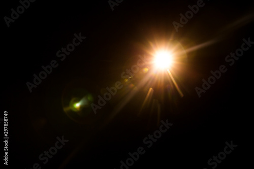 Photo abstract lens flare red light over black background