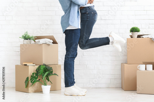 Cropped of couple in love having fun in new house