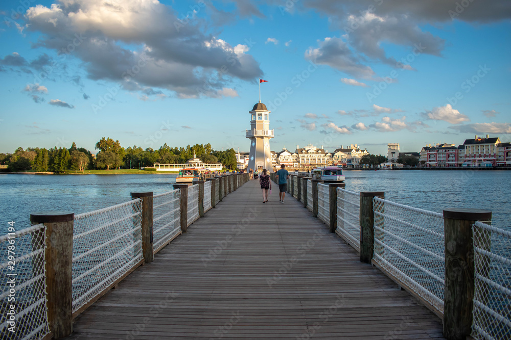 Fototapety, obrazy: Orlando, Florida. October 11, 2019. People walking on pier on the way to lighthouse at Lake Buena Vista 89