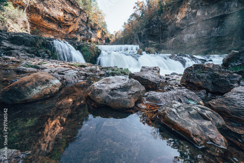 Fototapeta Waterfall at Willow River State Park in Hudson Wisconsin in fall