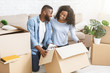 Excited black couple getting ready for moving out