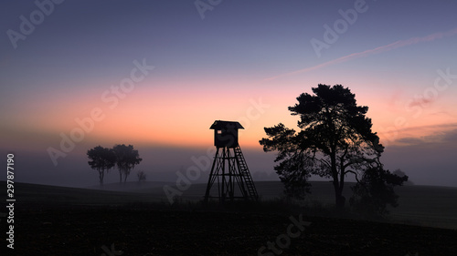 Платно  Silhouette of a hunting tower at dawn.