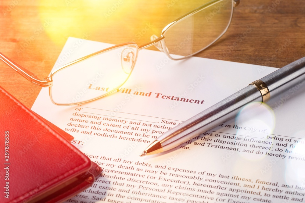 Glasses and pen with a Last Will and Testament