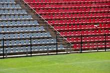 Empty Red And Grey Seating At The Rand Soccer Football Stadium, Soweto, South Africa, For Opposition, Two Competing Teams