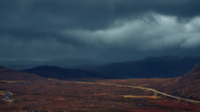 Dark Clouds Over Distant Mountains