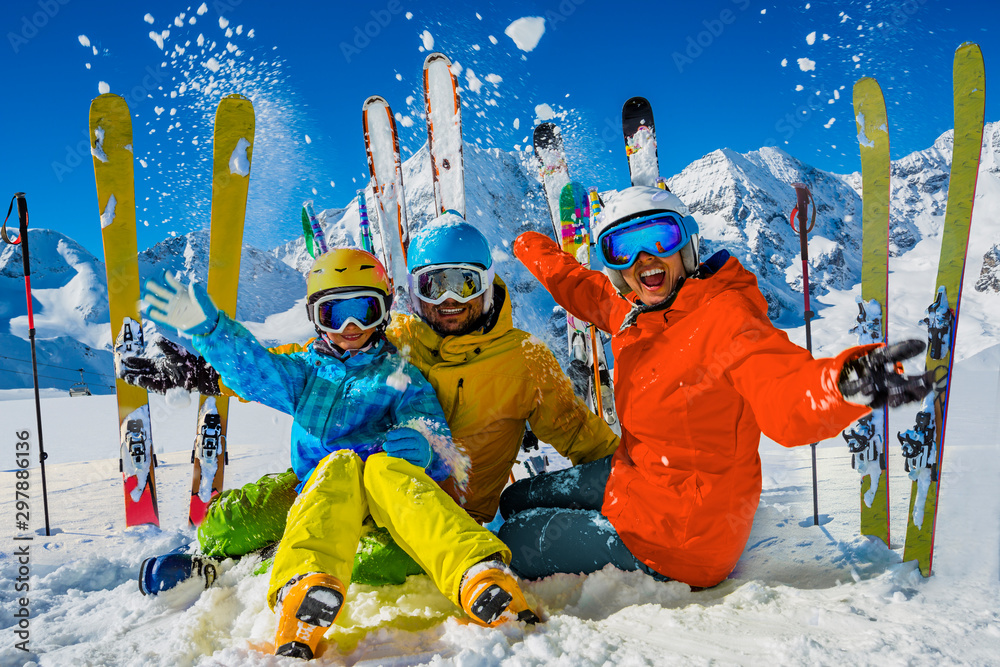 Fototapety, obrazy: Happy family enjoying winter vacations in mountains. Playing with snow, Sun in high mountains. Winter holidays.