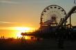 LENS FLARE: Beautiful shot of golden sun rays illuminating Santa Monica Pier.