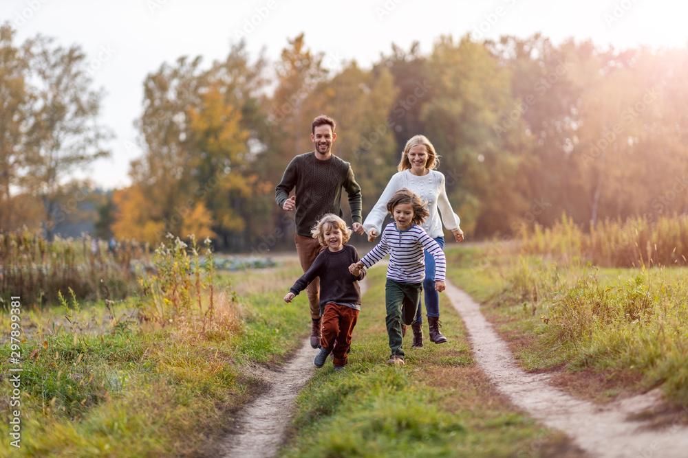 Fototapeta Young family having fun outdoors