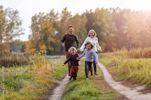 Young family having fun outdoors - 297899381