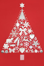 Christmas Tree Abstract With Silver And White Decorations, Baubles And Symbols On Red Background With Copy Space. Traditional And Festive Holiday Theme.