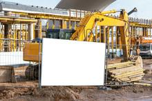 Yellow Excavator Working On Di...