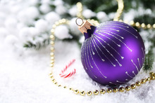 Christmas Bauble With Beads, Candy And Fir Tree Branches On White Snow