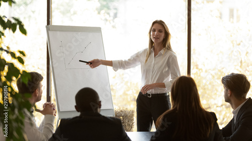 Fototapeta Female speaker give flip chart presentation at conference training meeting obraz