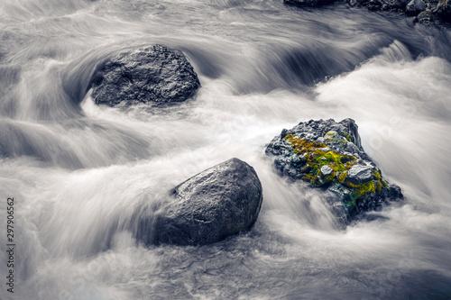 Papiers peints Taupe Long exposure of water flowing over rocks in stream,