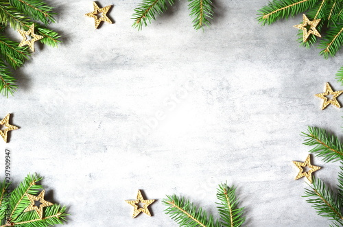 Christmas background with decorations and yellow stars on the gray stone background