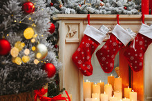Fireplace With Christmas Stockings In Festive Room Interior